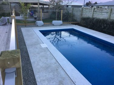White Quartzite Bullnose Coping w concrete surrounds