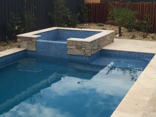 Travertine Bullnose Pool Coping with matching Ashlar Paving