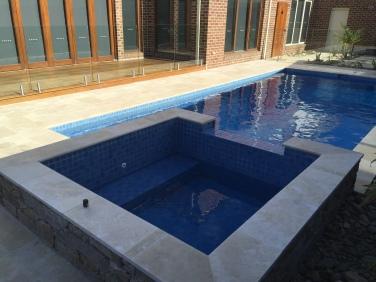 Travertine Bullnose Pool Coping with matching Ashlar Paving