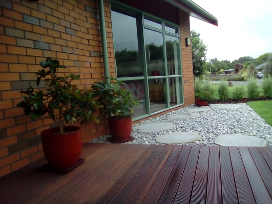 Natural Cut Bluestone Steppers with river stones
