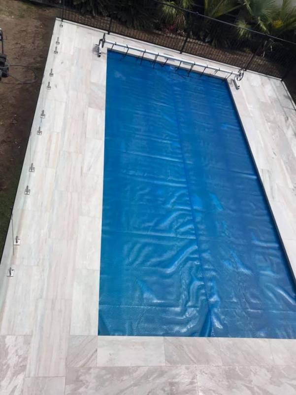 White Quartzite Dropface Pool Coping w matching paving (wet)