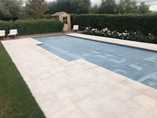 Chambolle Square Edge coping with matching paving