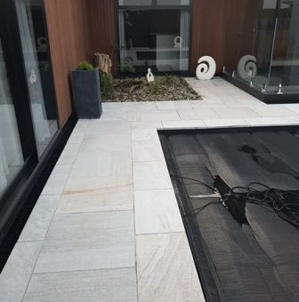 White Quartzite Square Edge with matching paving_wet