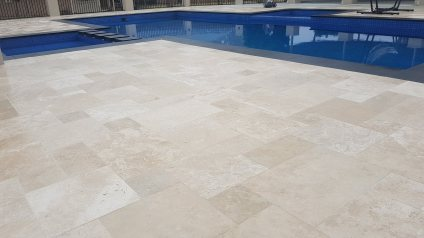 Classic Travertine Paving with Black Granite coping